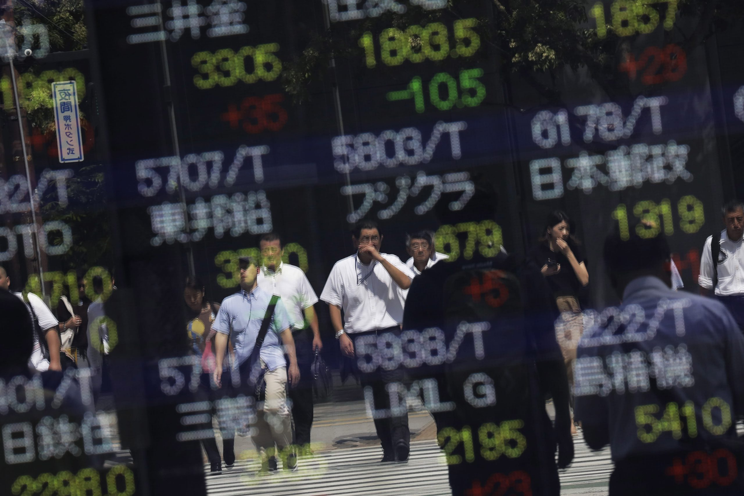 Stocks in Asia mixed ahead of Fed interest rate decision