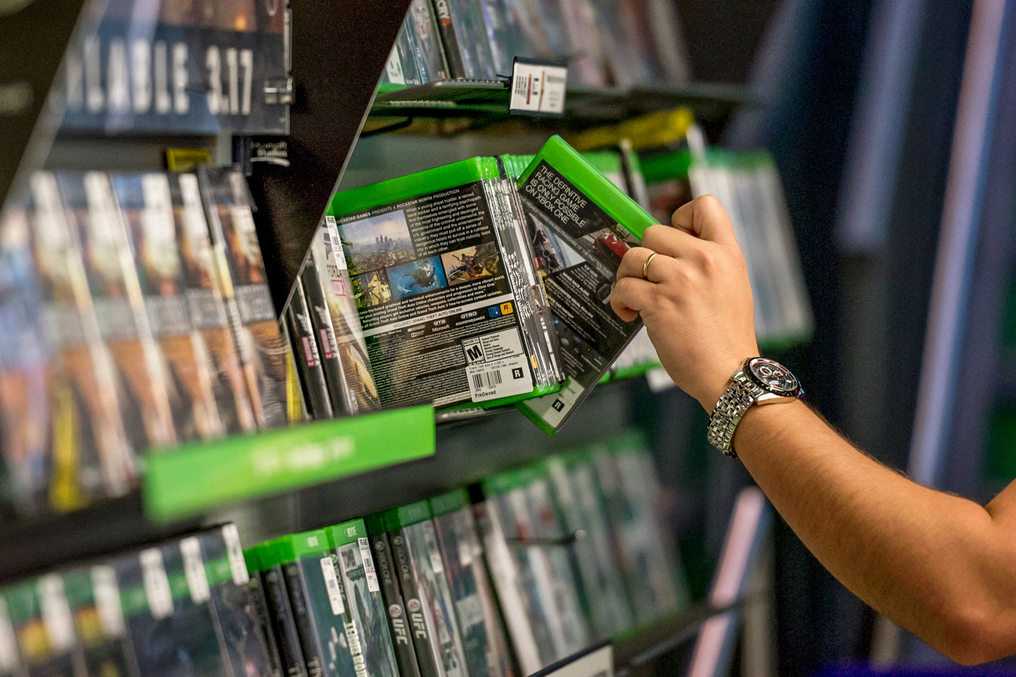 Stocks making the biggest moves midday: GameStop, Dropbox, Home Depot and more