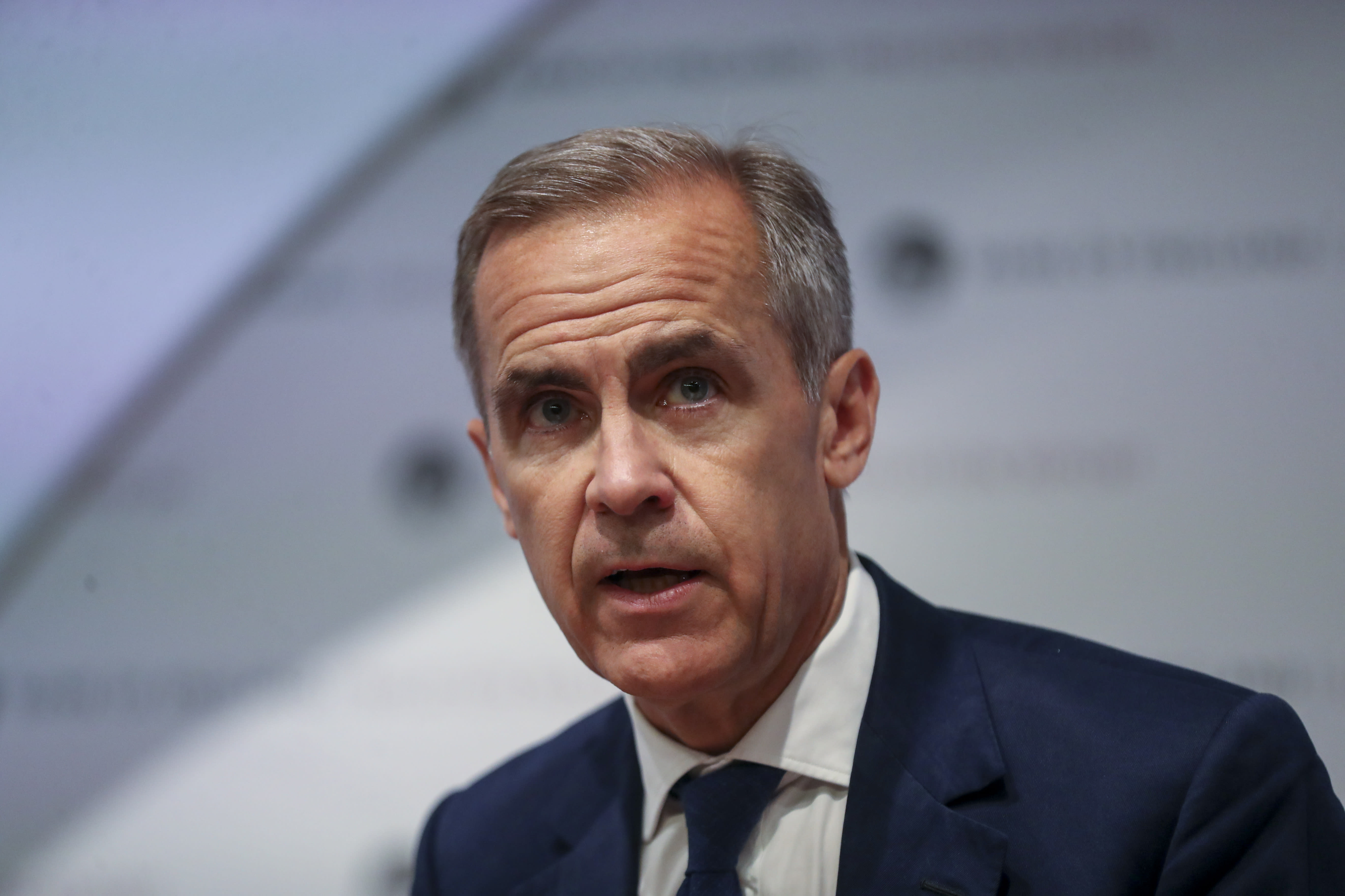 Bank of England holds rates steady and lowers UK growth forecast