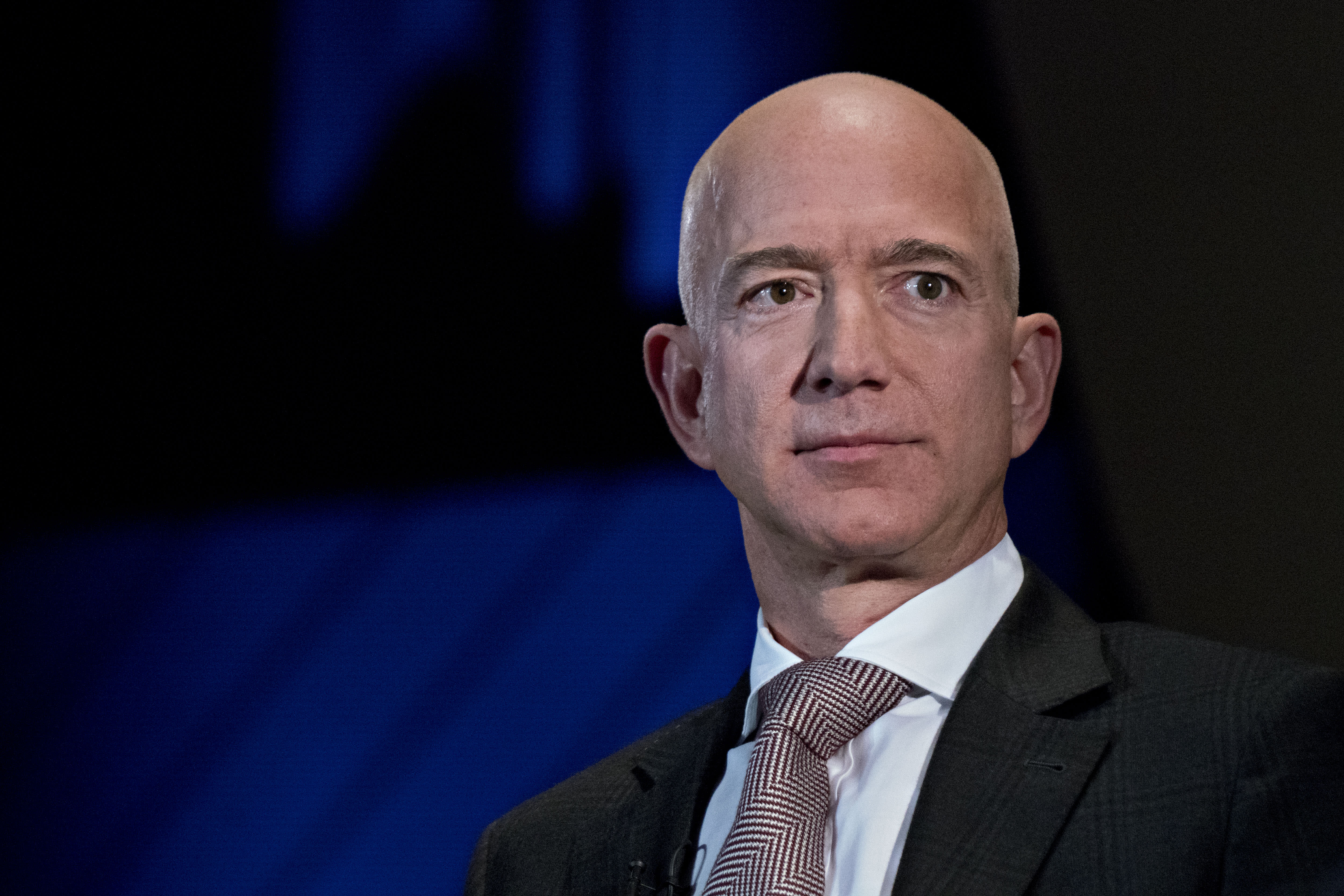 Stock market live updates: Dow down 100, Amazon up 10% to $1 trillion, Caterpillar's warning