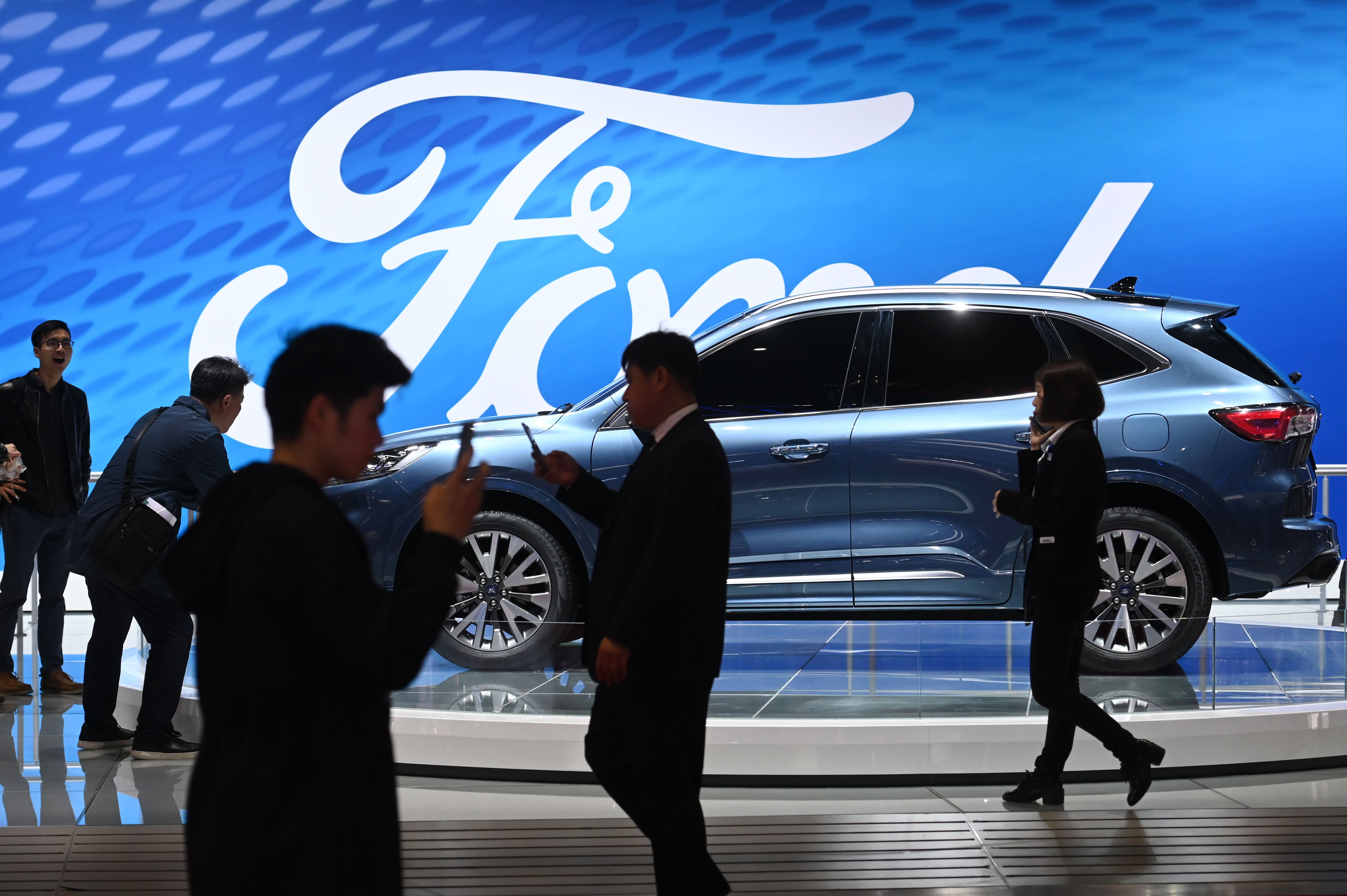 Stocks making the biggest moves midday: Ford, Tesla, Coty, Snap, Spotify & more