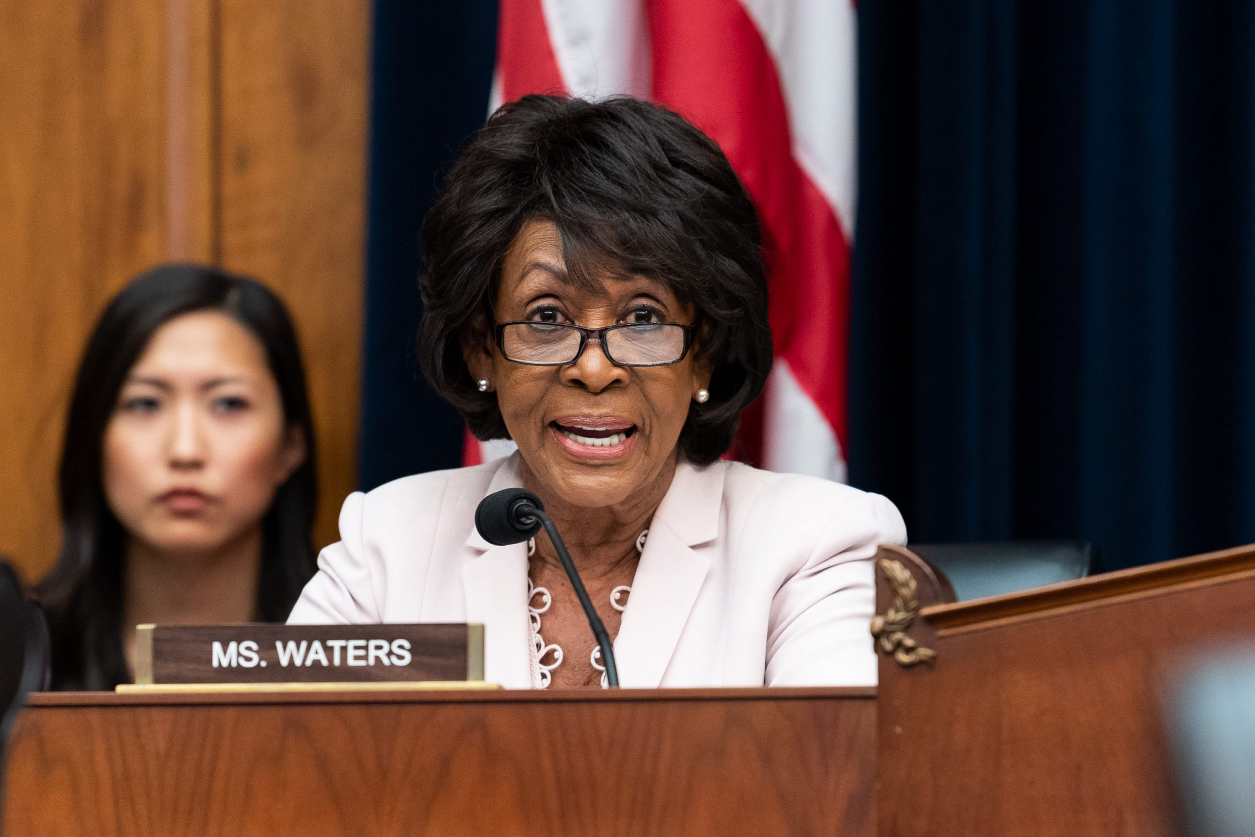 Democratic Rep. Maxine Waters sees little difference in Bloomberg using his fortune and others tapping donors