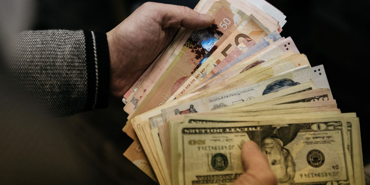 Global Stocks and Currencies Slide as Cash Shortage Worsens