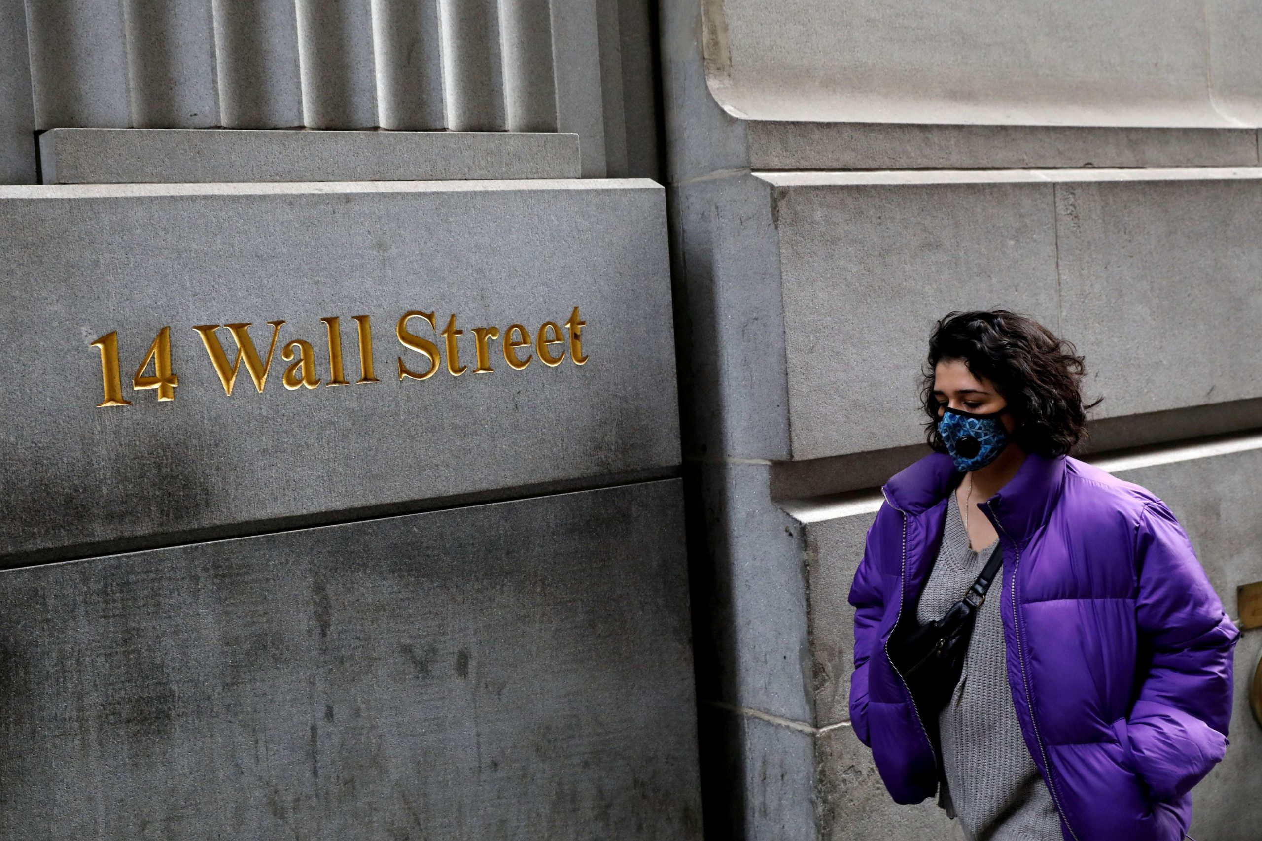 Dow futures fall more than 200 points amid concerns over reopening the economy