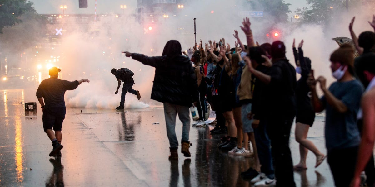 Similar images emerge from Hong Kong, Minneapolis as police use tear gas