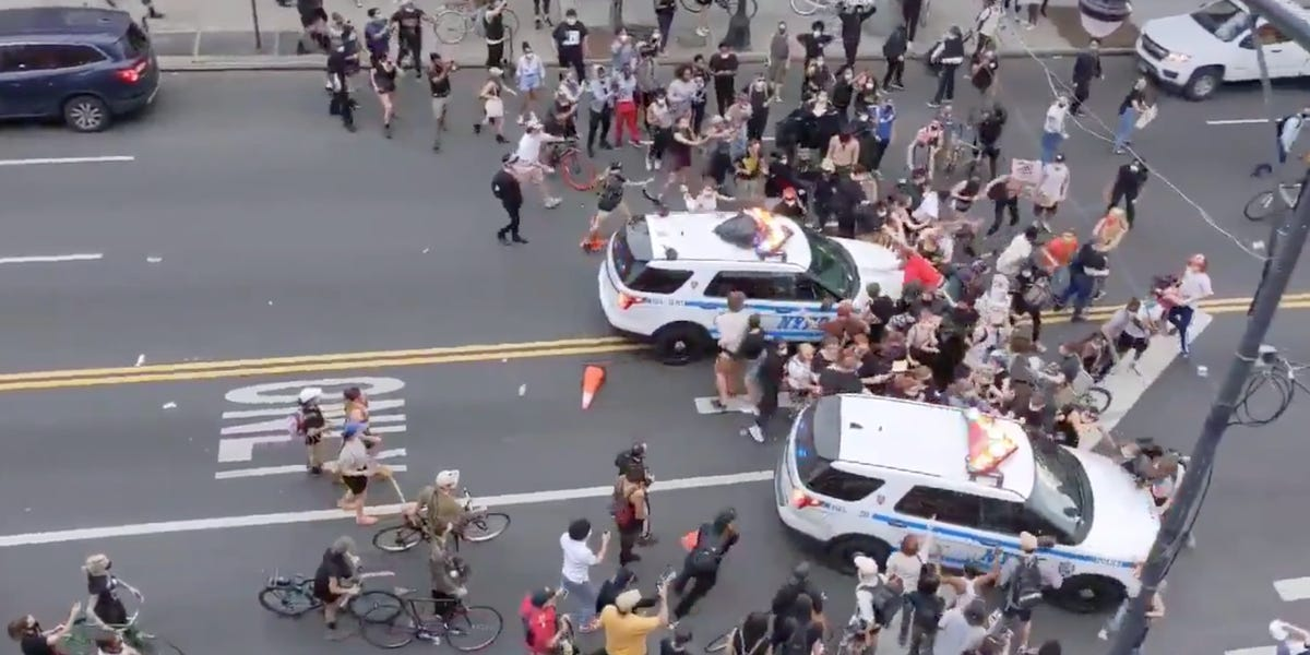 Videos show NYPD cruisers ramming into protesters behind a barricade and sending bodies flying