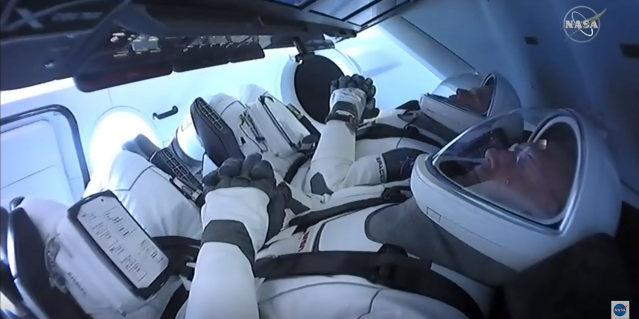 Elon Musk's SpaceX Capsule Links Up With Space Station