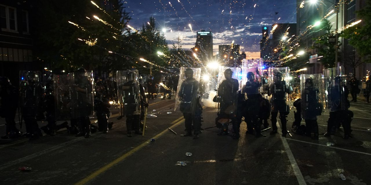 Curfews Fail to Deter Overnight Violence Following Peaceful Protests