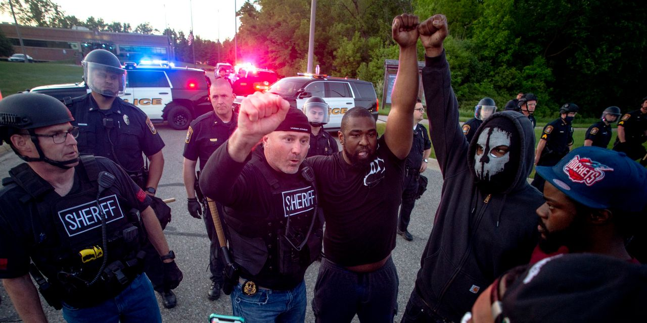 Police Acts of Empathy Defuse Some Protest Tension