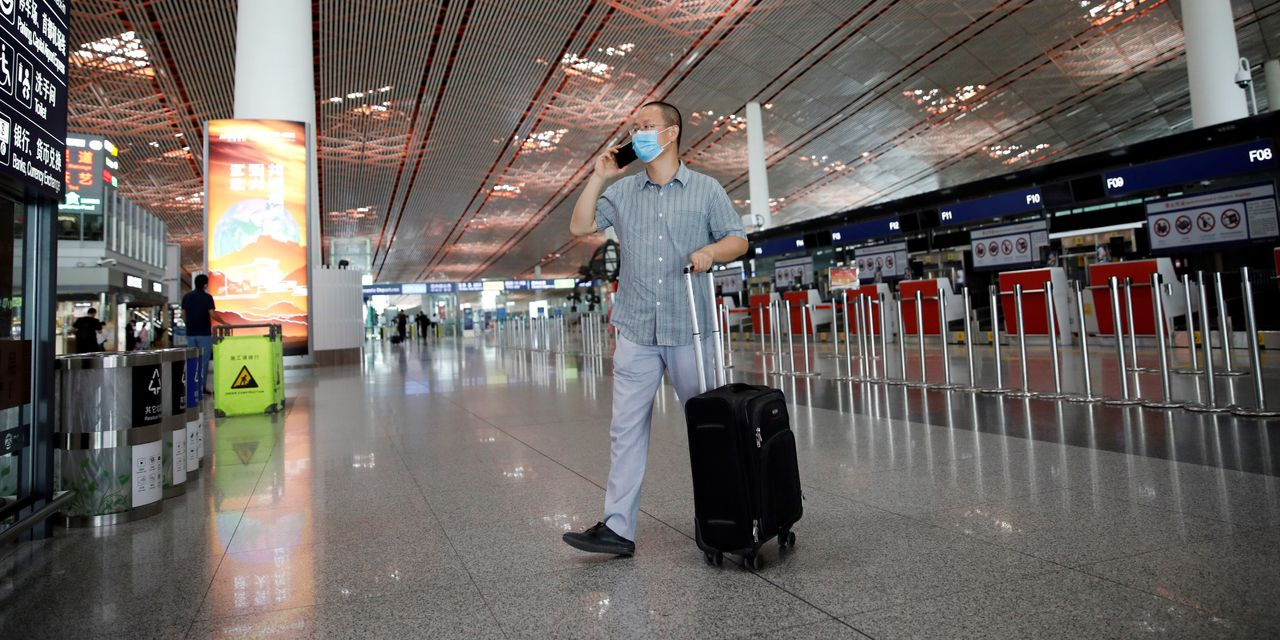 China Tightens Controls Over Beijing as Coronavirus Infections Spread