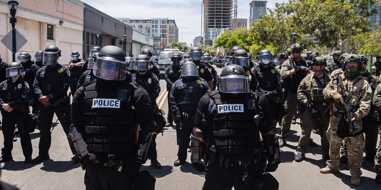 Despite Calls to Defund the Police, Some Cities Are Spending More
